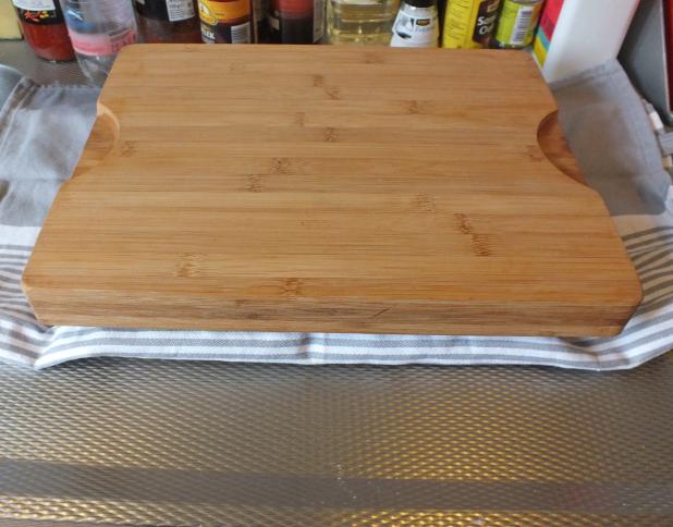 zware snijplank on top en zo de koelkast in